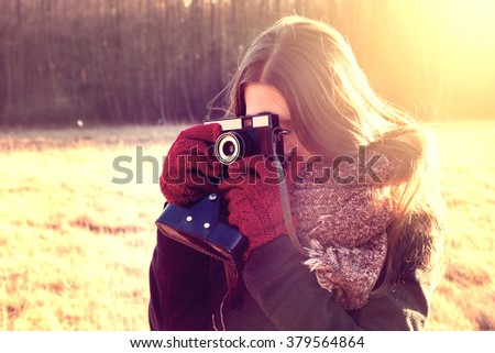 Young hipster girl with retro vintage camera. Instagram vintage picture. - stock photo