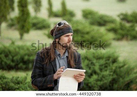 Young hipster guy with the tablet.