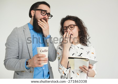 Young hipster man and woman in glasses yawning tired with coffee cup isolated on the blank white background - stock photo