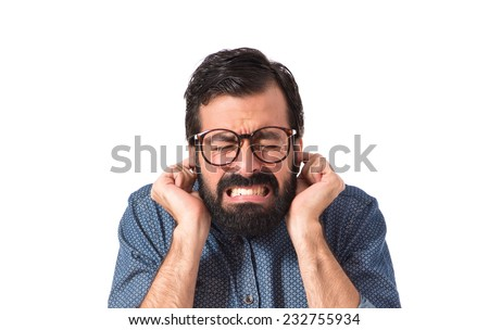 Young hipster man covering his ears - stock photo