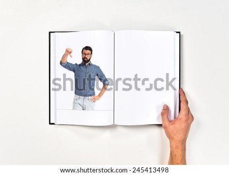 Young hipster man doing bad signal printed on book - stock photo