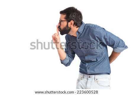 Young hipster man making silence gesture