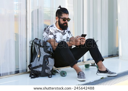 Young hipster man on the phone - stock photo