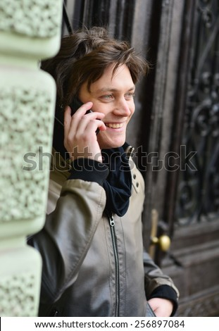 Young hipster man using smart phone - stock photo