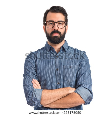 Young hipster man with his arms crossed