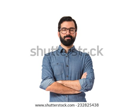 Young hipster man with his arms crossed - stock photo