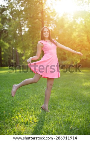 Young hipster model woman Casual Girl in field in Sunset in spring, summer landscape background Springtime Summertime. Allergic to pollen of flowers Allergy Backlit Sun Light Autumn Glow Sun Sunshine  - stock photo