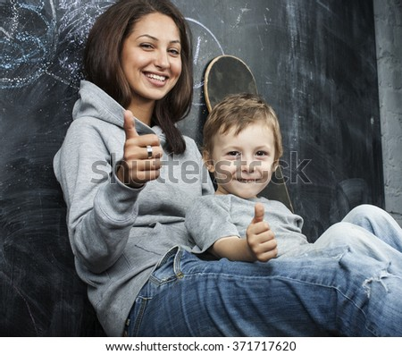 young hipster teenage girl sitting with her brother in classroom multinational - stock photo