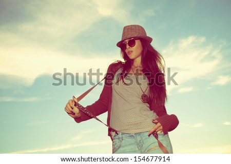 young hipster woman portrait with hat and sunglasses outdoor shot retro colors - stock photo