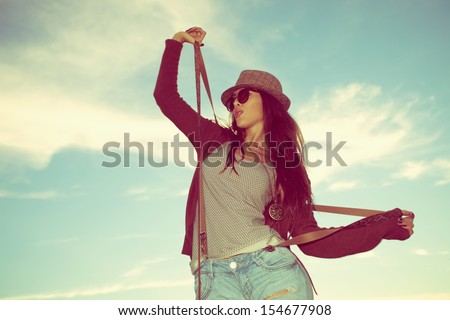 young hipster woman with hat and sunglasses outdoor shot - stock photo