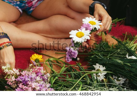 Young hipster women making flower wreaths circle closeup