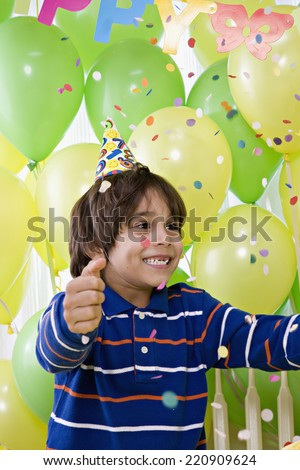 Young Hispanic boy at birthday party