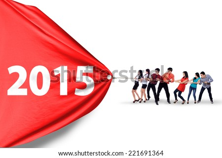 Young hispanic business team draw number 2015, isolated over white background