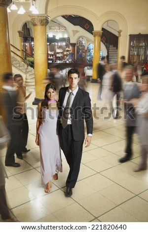 Young Hispanic couple in evening wear - stock photo