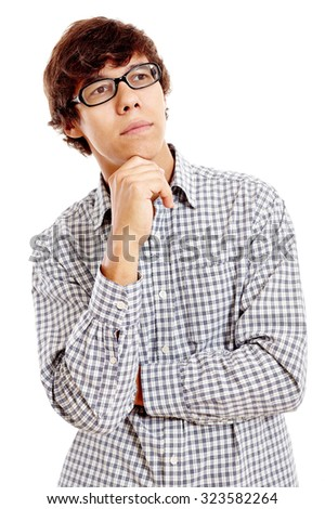 Young hispanic man wearing blue checkered shirt and black glasses standing with hand on his chin and thinking isolated on white background - planning concept - stock photo