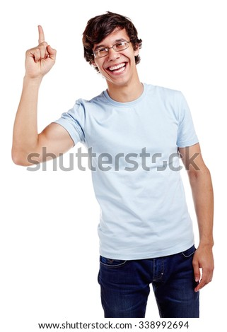 Young hispanic man wearing glasses, blue t-shirt and jeans showing up with his index finger and smiling isolated on white background - presentation concept - stock photo