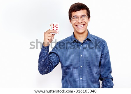 Young hispanic man wearing jeans shirt and glasses smiling and holding Jack Ten in his hand against white wall - gambling concept
