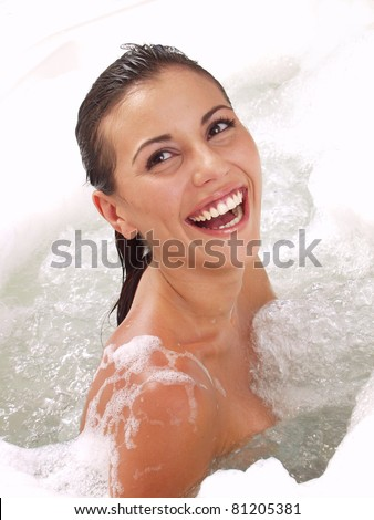 Young hispanic woman inside a jacuzzi.