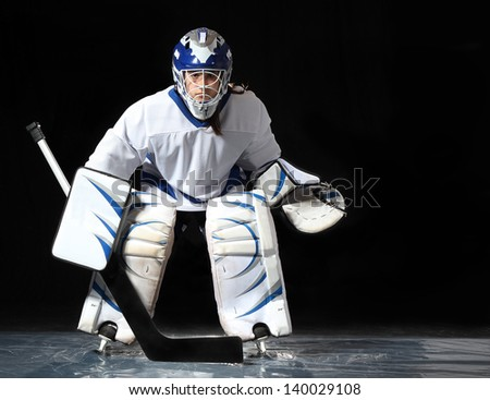 Young hockey goaltender in a ready position. - stock photo