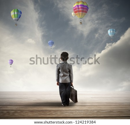 Young hopeful businessman searching for his future - stock photo