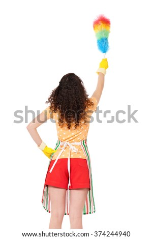Young housewife holding duster - isolated on white background - stock photo