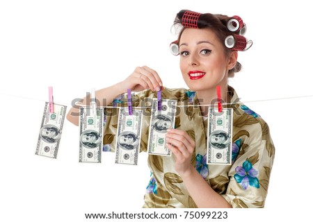 Young housewife is hanging hundred dollar bills on clothesline on a white background.  Money concept. - stock photo