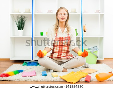 Young housewife is relaxing after cleaning,Relaxation after cleaning - stock photo