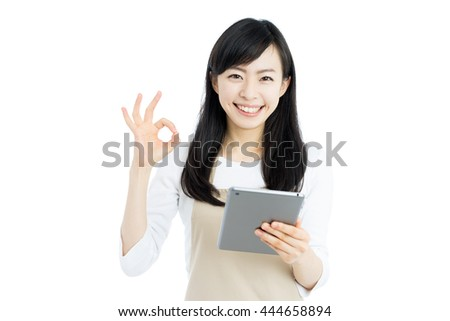 young housewife with apron holding a digital tablet isolated on white background - stock photo