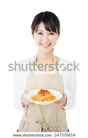young housewife with apron holding spaghetti, isolated on white background