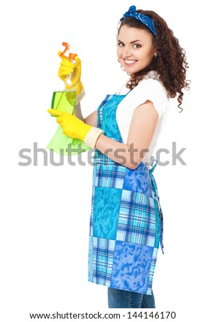 Young housewife with cleaning cloth and spray bottle, isolated on white background - stock photo