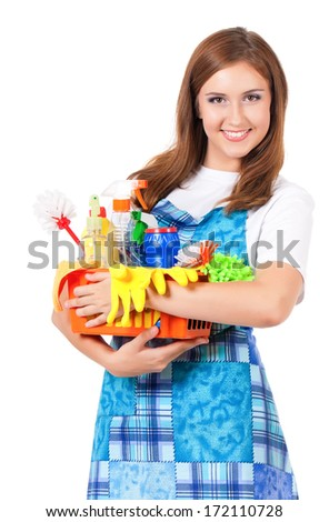Young housewife with cleaning supplies, isolated on white background - stock photo