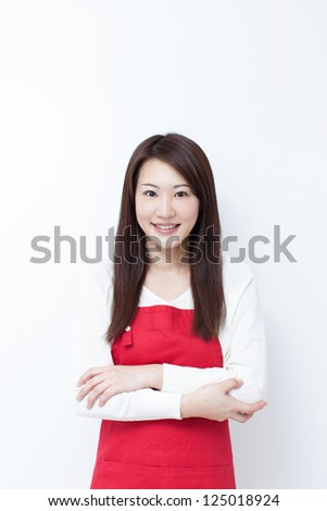 young housewife with red apron - stock photo