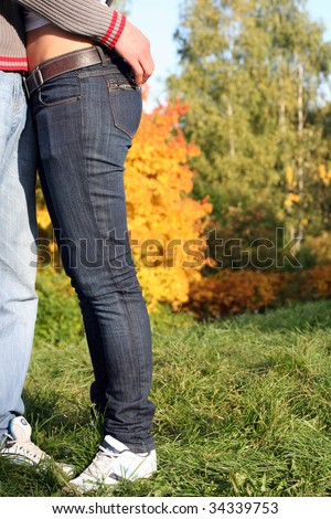 Young husband hugging wife - stock photo