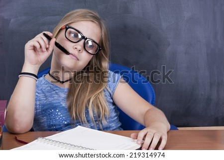 Young in studio on table close-up portrait - stock photo