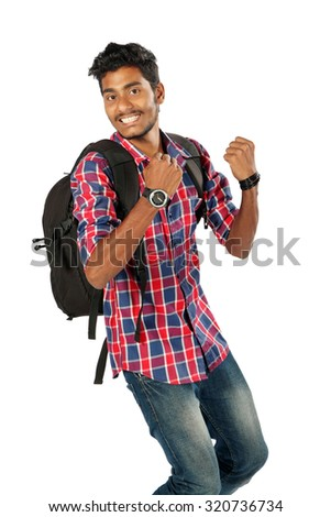 Young Indian boy student jumping isolated in white with backpack - stock photo