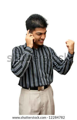 Young Indian business man using cellphone - stock photo