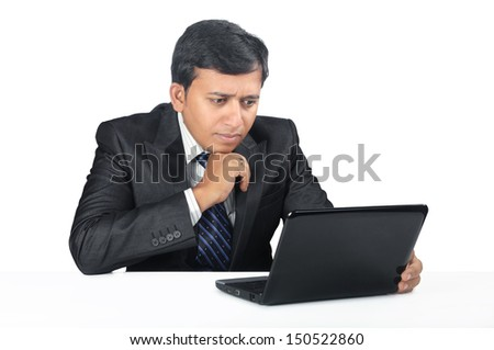 Young Indian business man with Laptop