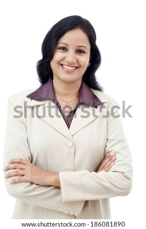 Young Indian business woman with arms crossed against white