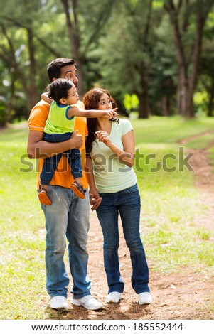 young indian family relaxing in the forest  - stock photo