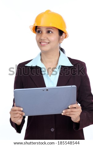 Young Indian female engineer with tablet against white background - stock photo