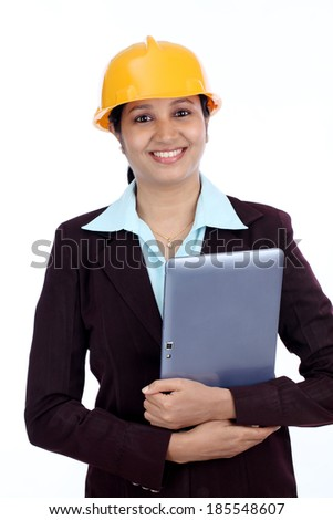 Young Indian female engineer with tablet against white background