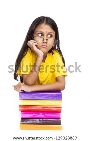 Young indian girl student holding her hands on books. Isolated on white background