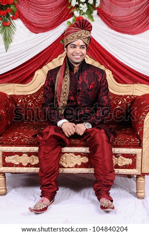young indian groom in a traditional clothing. - stock photo