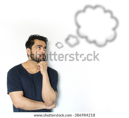 Young Indian Man thinking of thought bubble on white Background - stock photo