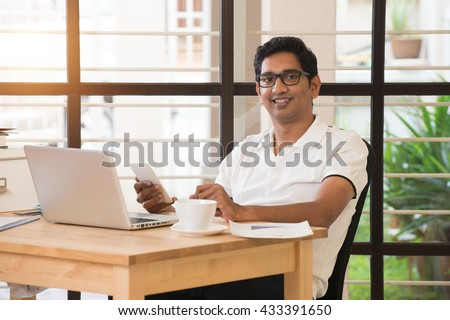 young indian man working from home office - stock photo