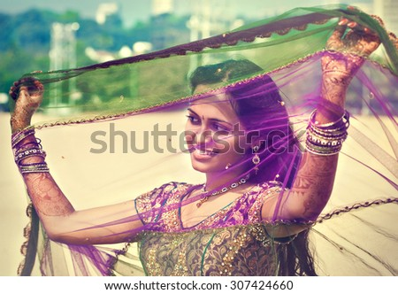 Young  indian  pretty woman in indian dress - stock photo