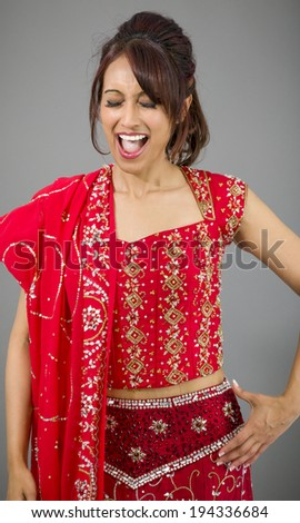 Young Indian woman looking excited - stock photo
