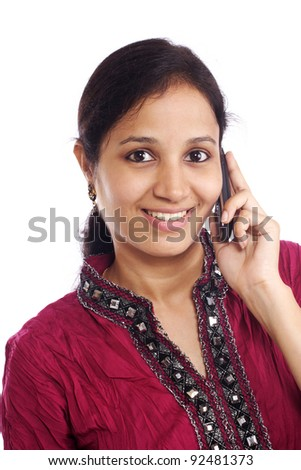 Young Indian woman talking on cell phone