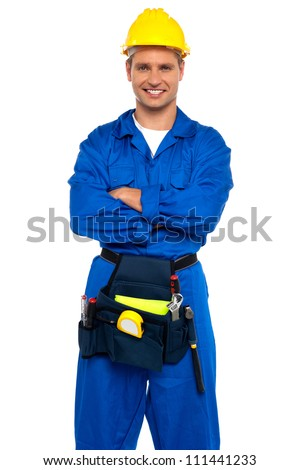 Young industrial contractor posing with crossed arms isolated over white background