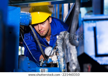 young industrial machine operator at work - stock photo